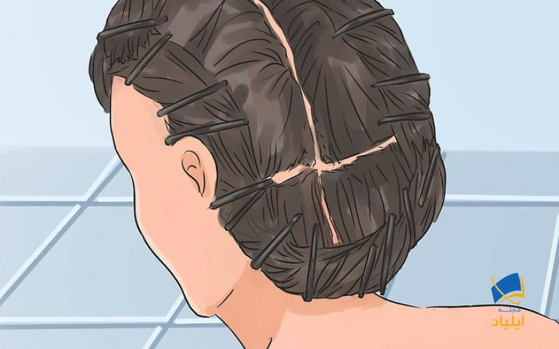 از قسمت پایین شروع کنید و موها را با گیره سفت کنید