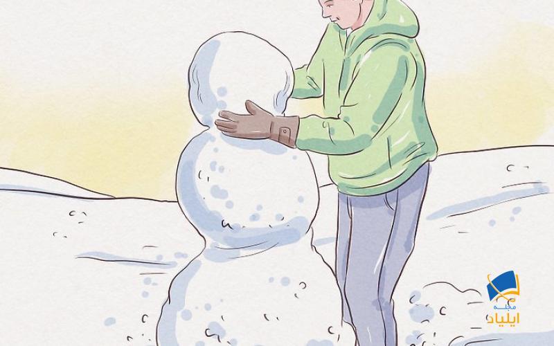 غلتاندن برف برای ساخت آدم برفی